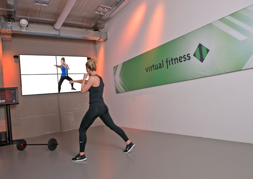 Virtual Fitness Video Wall Deluxe Full HD video wall bestaande uit 4 x 55 Samsung Professional LED monitor (24/7) Inclusief processor en wandbeugel Afmeting