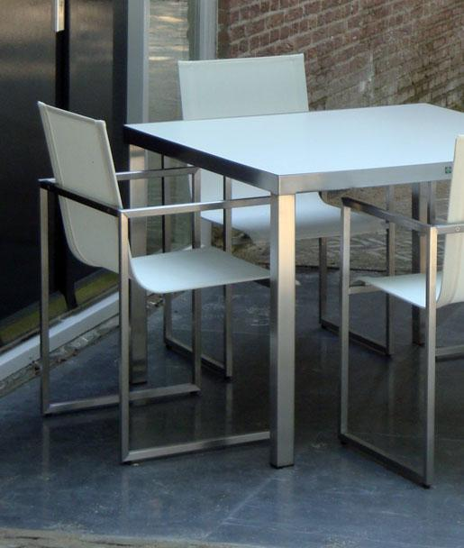 #31 DINING: The #31 DINING is a design chair made from stainless steal with a brushed finish and is for outdoor use. The seats are made from SUNBRELLA Sling and SILVERGUARD fabrics.
